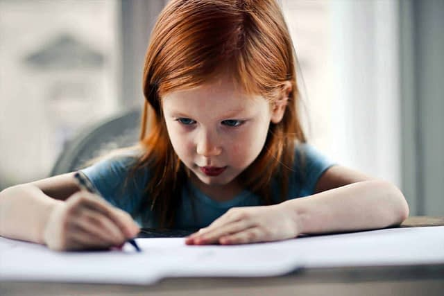 Red haired girl studying