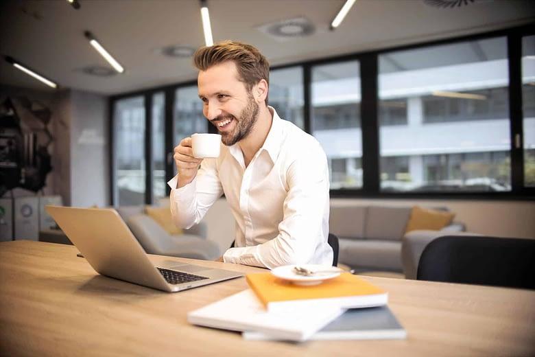 Businessman with Macbook pro & coffee